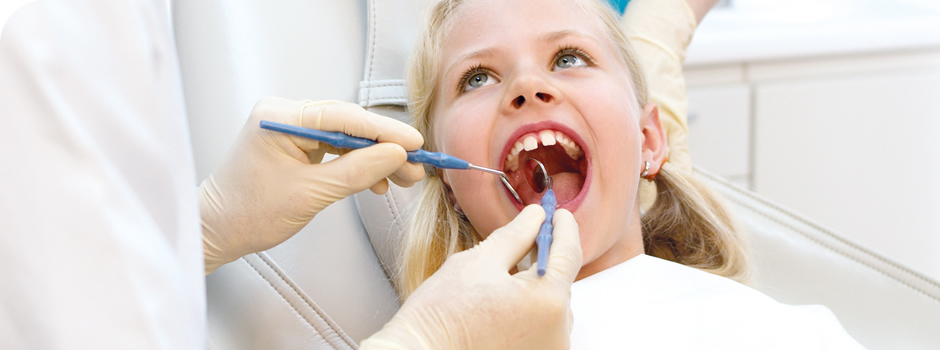 Girl having dental treatment